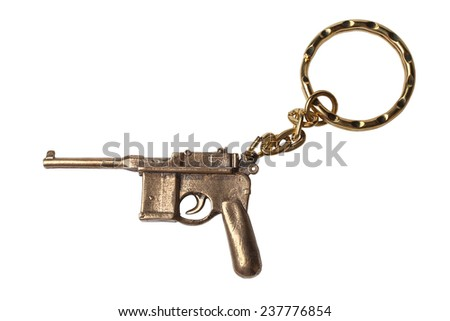 Trinket for the keys as a Pistol Mauser isolated on white background - stock photo