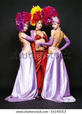 trio from cabaret over dark background - stock photo