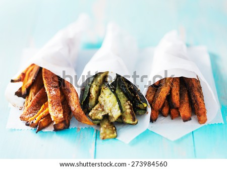 trio of carrot, zucchini, and sweet potato fries shot head on - stock photo