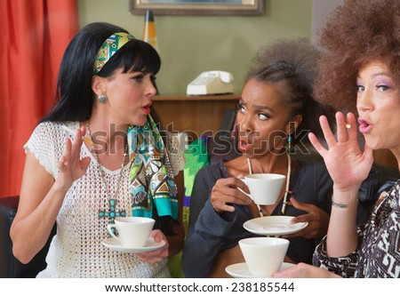 Trio of cute 1960s style women smoking and drinking coffee - stock photo