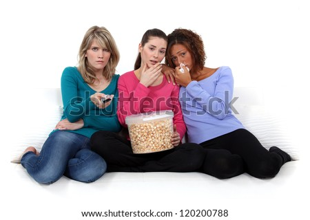 trio of girls crying over sad movie - stock photo