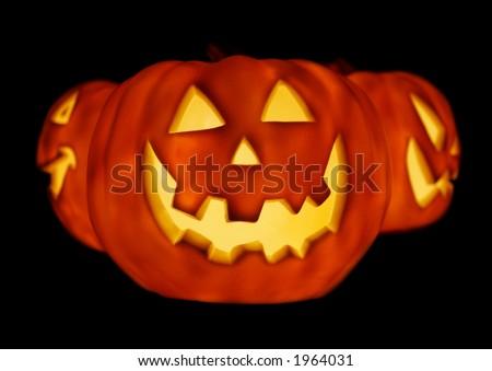 Trio of Glowing Pumpkins for Halloween - stock photo