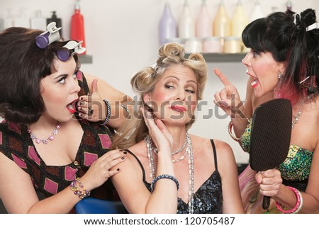 Trio of pretty Caucasian women showing off in hair salon