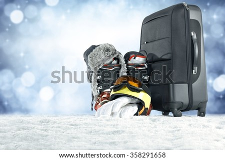 trip and suitcase on snow