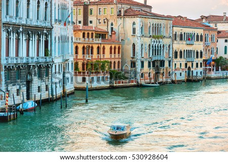 Trip boat on Grand Canal at evening in Venice, Italy