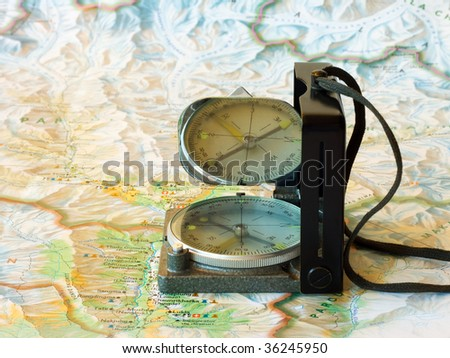Trip or travel concept with map and compass - stock photo