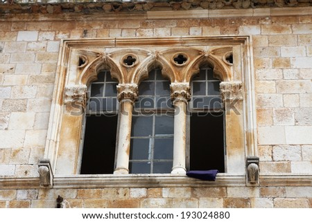 Triple ancient stone ornament window. Croatia - stock photo