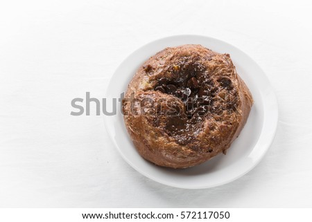 Triple Chocolate Bun With Chocolate Chips And Chocolate Custard Filling White Background Copy Space
