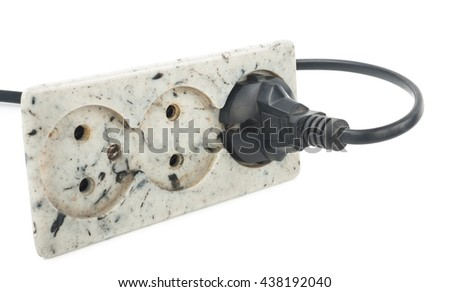 Triple electrical socket on white wall with  plugged cable - stock photo
