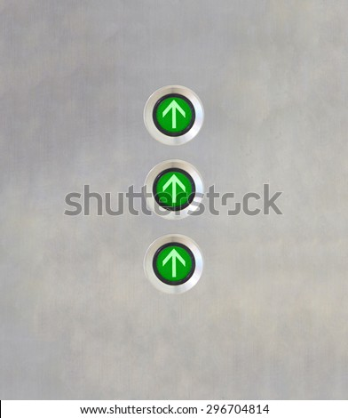 Triple green light Elevator Button up direction on stainless plate. High speed concept. - stock photo