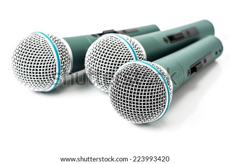 Triple green microphone isolated on white background - stock photo