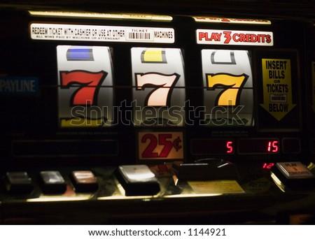 triple 7's at slot machine - stock photo