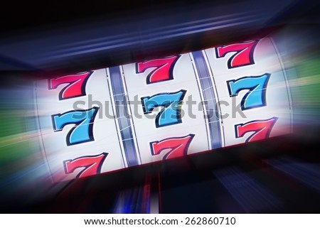 Triple Seven Slot Machine Win. Casino Classic Slot Machine Concept Photography. - stock photo