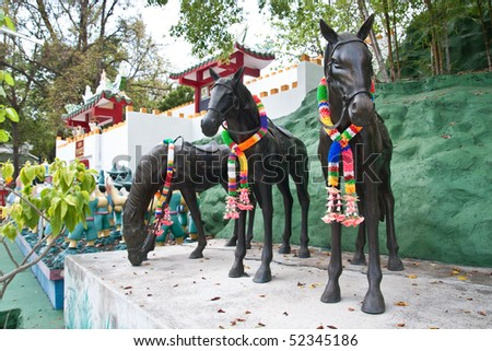 triple war horse in chinese temple - stock photo