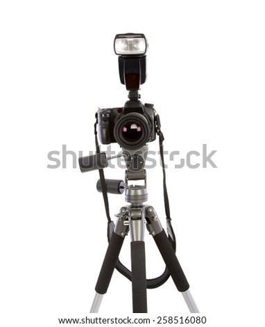 Tripod and camera isolated on white - stock photo