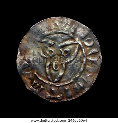 Triquetra symbol on Viking age silver denar coin - stock photo