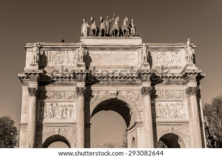 Triumphal Arch (Arc de Triomphe du Carrousel) at Tuileries gardens in Paris, France. Monument was built between 1806 - 1808 to commemorate Napoleon's military victories. Vintage.  - stock photo