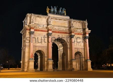Triumphal Arch (de Triomphe du Carrousel) in front of Louvre, Paris, France. - stock photo