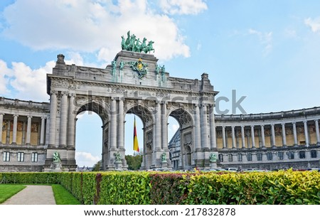 Triumphal Arch in Cinquantenaire Park in Brussels with flag of Belgium - stock photo