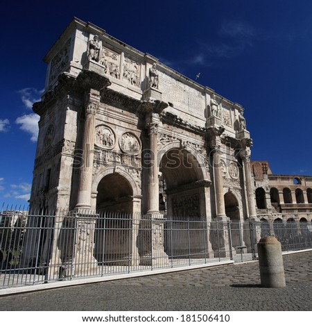 Triumphal arch of Constantine and coliseum in background at Rome, Italy - stock photo