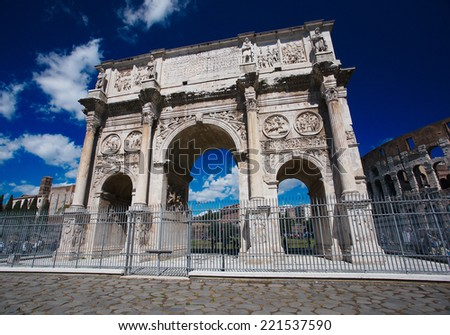 Triumphal arch of Constantine and Colosseum in background at Rome, Italy - stock photo