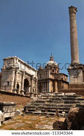 Triumphal arch of the Emperor Septimius Severus, early medieval church of Santi Luca e Martina and the Column of Phocas at the Roman Forum.
