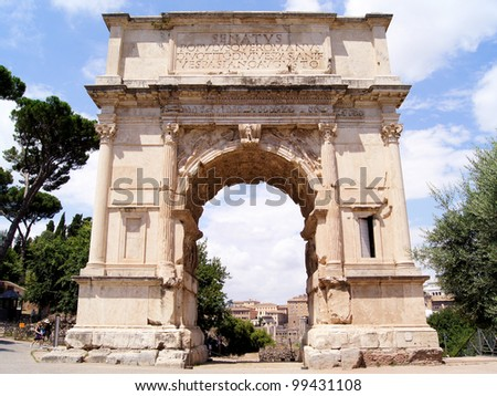 Triumphal Arch of Titus in the ancient Roman Forum - stock photo