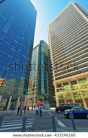 Triune sculpture and Penn Center with Skyline of skyscrapers in Philadelphia, Pennsylvania, the USA. It is the main business district of the City. - stock photo