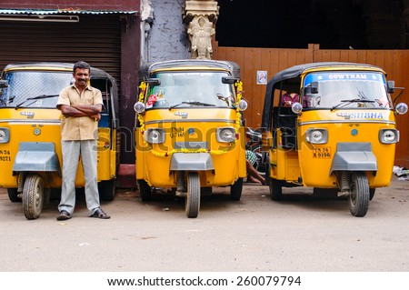 "Trivandrum, India - December 11, 2011: Indian auto rickshaws in street. Auto rickshaws (called ""autos"" or ""tuk tuk"") provide cheap transportation in indian cities instead of taxies for short distances - stock photo"
