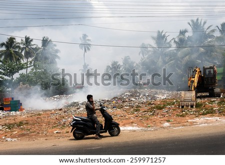 TRIVANDRUM, KERALA, INDIA, MARCH 04, 2015: Land and air pollution in India. Environmental hazard. Garbage being burnt in the open, a health hazard. Urban degradation.