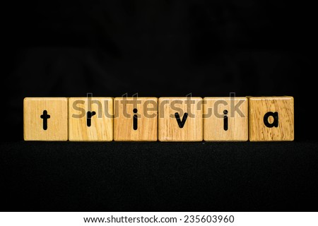 trivia wood Cubic on black background - stock photo