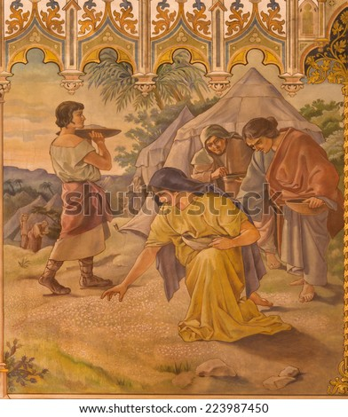 TRNAVA, SLOVAKIA - OCTOBER 14, 2014: The neo-gothic fresco of fhe scene as Israelites at gathering of manna by Leopold Bruckner (1905 - 1906) in Saint Nicholas church. - stock photo
