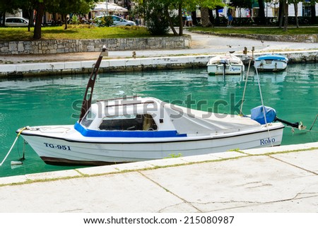 TROGIR, CROATIA - AUG 22, 2014: Boats in Trogir, Croatia. Trogir is a popular touristic destination of Croatia with the Old Town, which is a UNESCO World Heritage