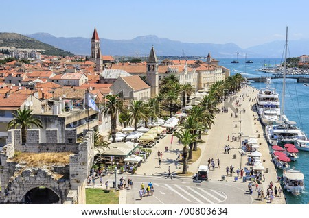 TROGIR, CROATIA - JULY 11, 2017: Embankment with a palm tree in the town of Trogir, Croatia.
