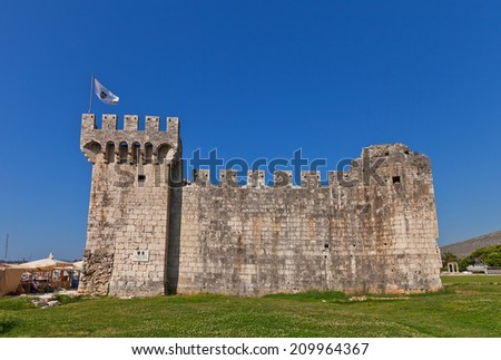 TROGIR, CROATIA - JULY 20, 2014: Side view of medieval Venice castle of Kamerlengo (Gradina Kamerlengo, circa 1437) in Trogir, Croatia. World Heritage site of UNESCO