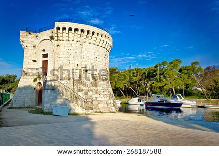 Trogir old stone tower by the sea, Dalmatia, Croatia - stock photo