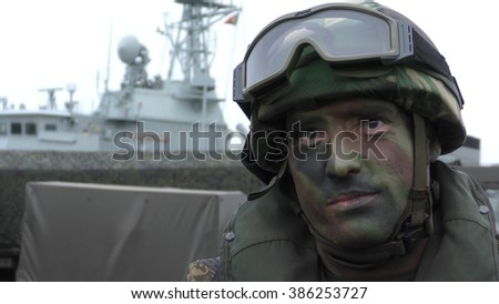 TROIA, PORTUGAL - NOVEMBER 05, 2015: A tough and brave Portuguese marine soldier is ready to fight during  NATO's Maritime day, Trident Juncture 15.