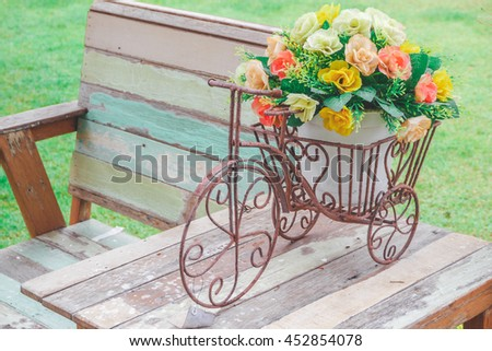 Trolley Cart flowers on Old wooden chair