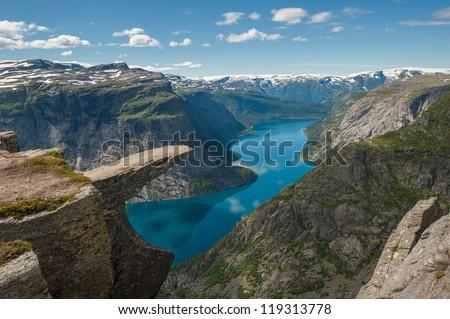 Trolltunga, Troll's tongue rock above lake Ringedalsvatnet, Norway - stock photo