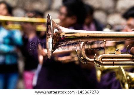 Trombones playing in a big band. - stock photo