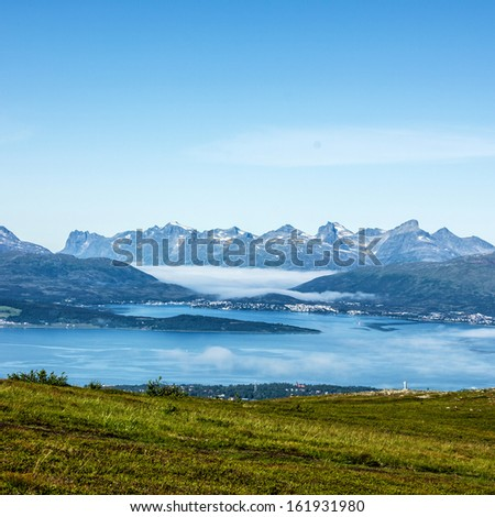 Tromso - panoramic view from mountain on Norwegian city Tromso beyond the Arctic circle, Norway. - stock photo