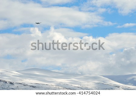 TROMSOE, NORWAY - APRIL 17, 2016: small school airplane climbing on blue sky from Langnes airport