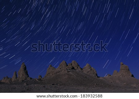 Trona Pinnacles Startrails in Night Sky California USA - stock photo