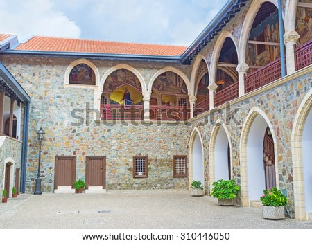 TROODOS, CYPRUS - AUGUST 2, 2014: The courtyard of the Kykkos Monastery, decorated with the mosaic icons on the terrace of the second floor, on August 2, 2014 in Troodos. - stock photo
