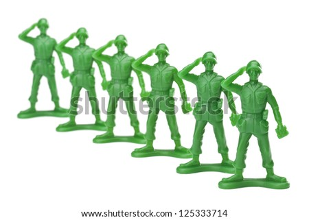 Troops of in lined military on a salute gesture against white background - stock photo