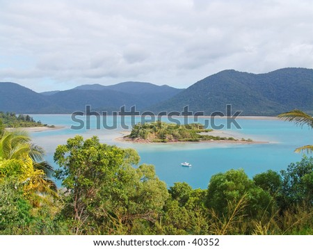 Tropical australia island and rainforest - stock photo