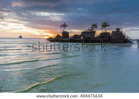 Tropical background sunset view from Boracay island at White Beach with traditional Philippines boats. Travel Vacation at Philippines, - stock photo