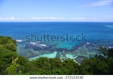 Tropical bay with coral reef at Ocho Rios, Jamaica - stock photo