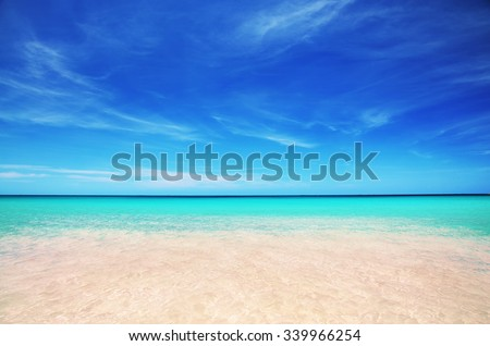 Tropical beach and beautiful clouds - stock photo