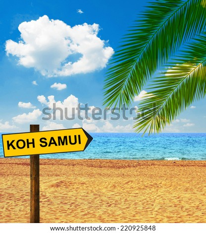 Tropical beach and direction board saying KOH SAMUI - stock photo